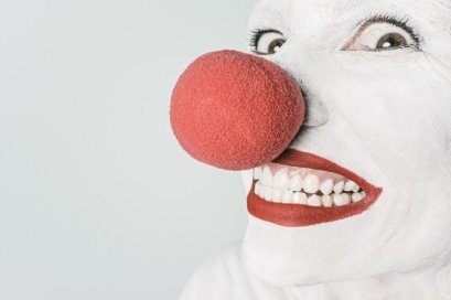 smiling-clown-with-red-nose-on-white-background